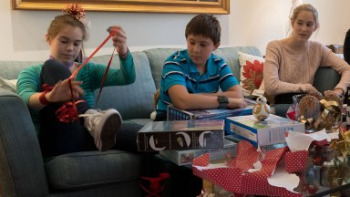 Photograph the fun on Christmas morning as the kid open presents.
