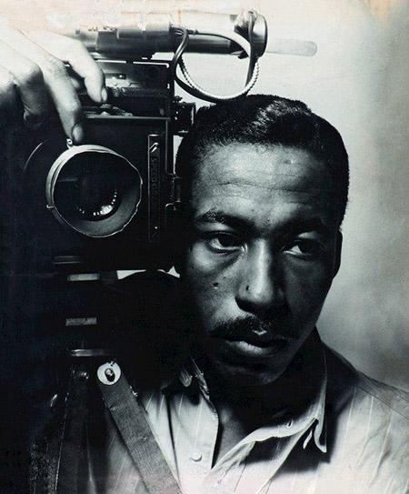 Gordon Parks with a camera