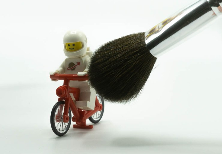 LEGO minifig and a makeup brush.