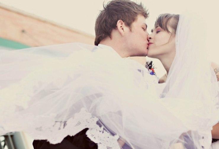 The bride's veil frames the couple.