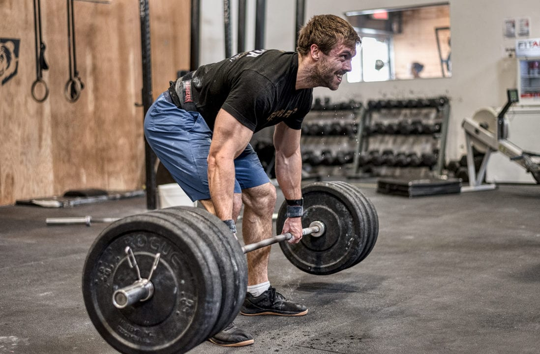 2018 CrissFit Games athlete Alexandre Caron does a heavy deadlift dripping sweat
