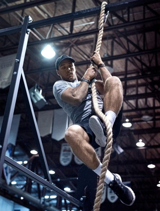 CrossFit athlete does a rope climb