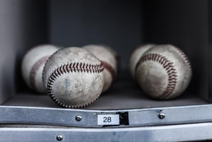 baseballs in dugout