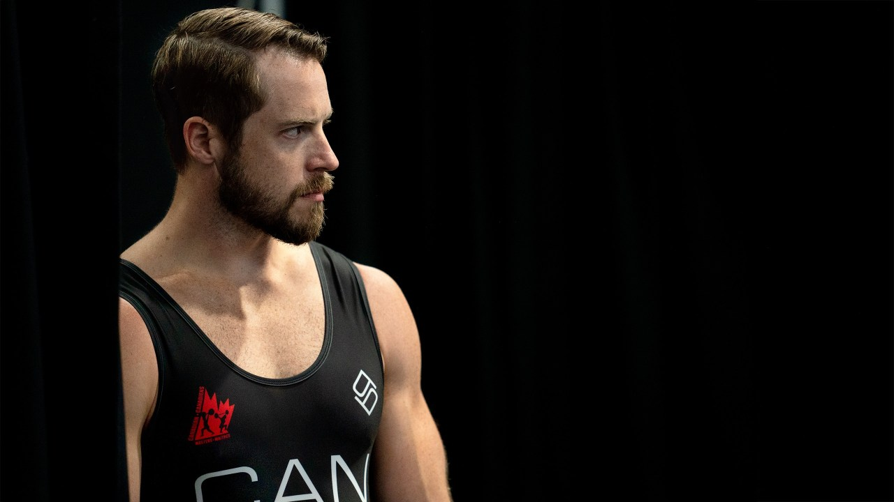 Weightlifting athlete waiting to perform behind the curtains