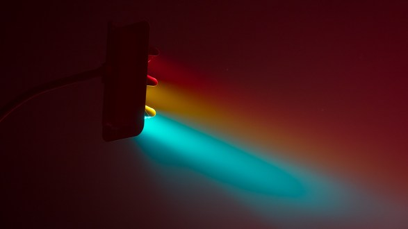 Traffic light colors glow in minimalist night photography