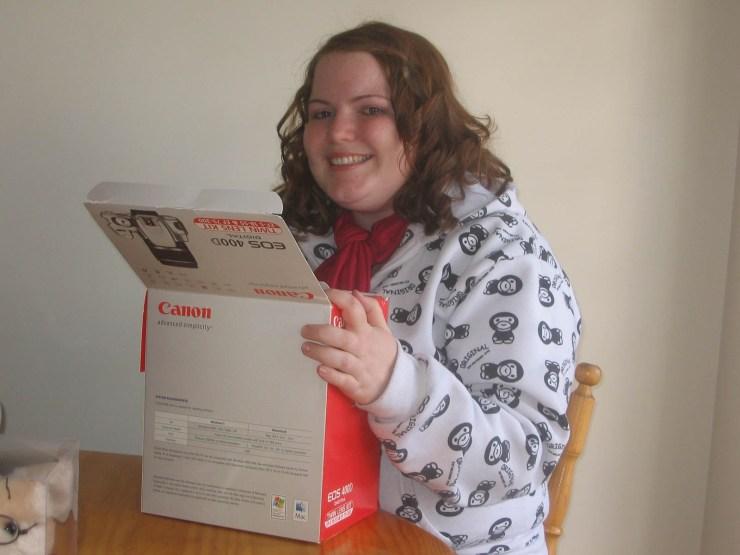 Woman holding camera box