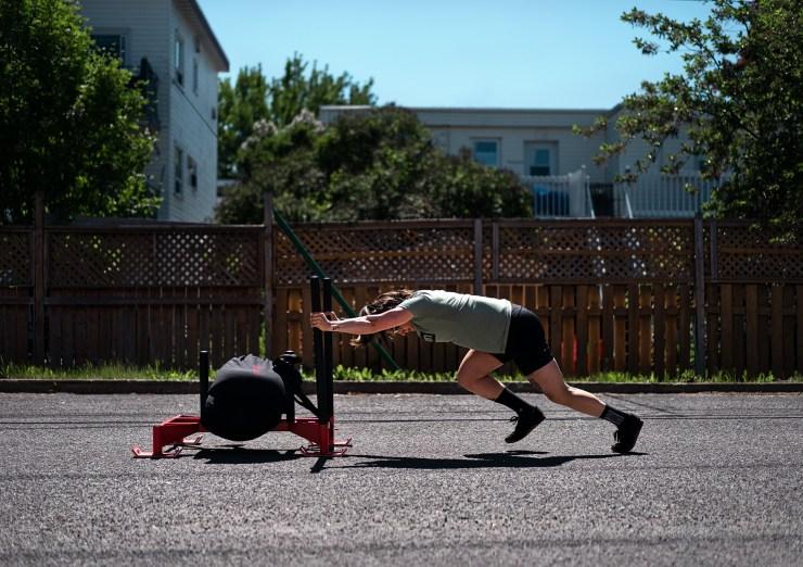 Female athlete sled blurred background