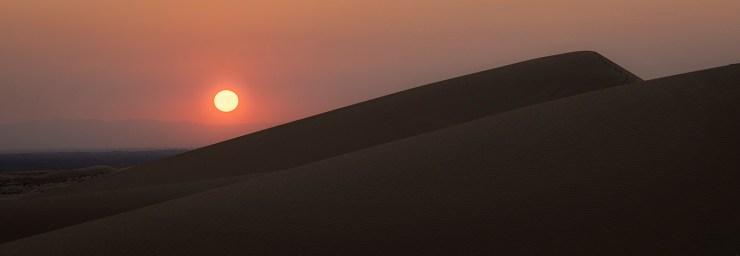 Sand dune sunset photo