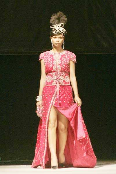 A model displays a 'Caftan' dress by Moroccan designer ...