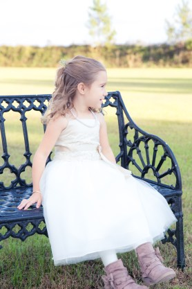 flower girl from wedding on a park bench in Myrtle Beach
