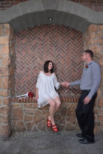 Photographers of Las Vegas - Wedding Photography - couple in brick arch