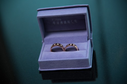 Photographers of Las Vegas - Wedding Photography - wedding rings in box on green and black background