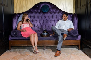 Photographers of Las Vegas - Wedding Photography - wedding couple sitting on couch with phone