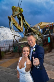 Photographers of Las Vegas - Vegas Strip Tour Photography - couple showing rings in front of mantis at container park