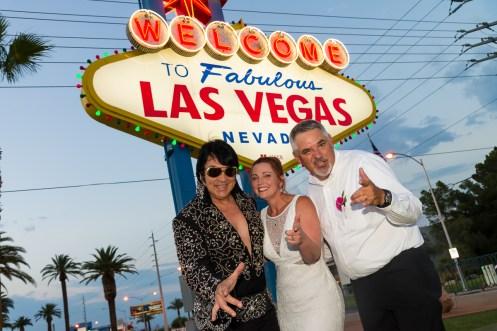 Photographers of Las Vegas - Wedding Photography - wedding couple at Vegas sign with Elvis impersonator