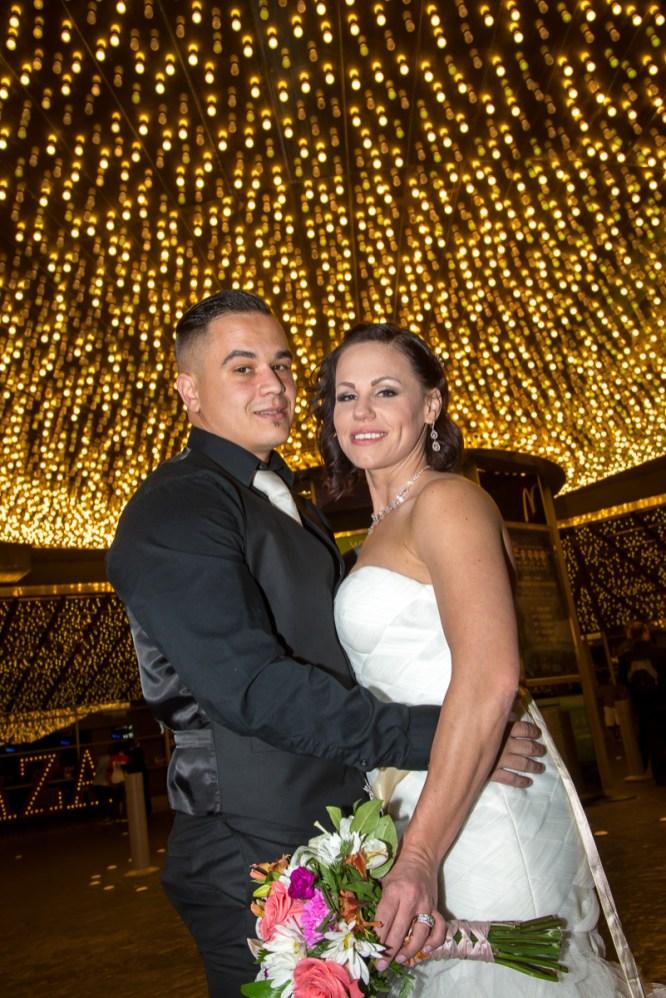 Photographers of Las Vegas - Wedding Photography - wedding couple under Vegas lights at plaza hotel