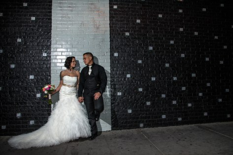 Photographers of Las Vegas - Wedding Photography - wedding couple bride and groom up against stylish wall