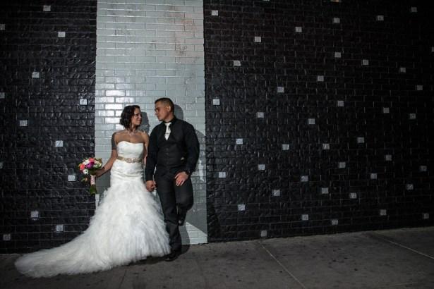 Photographers of Las Vegas - Wedding Photography - wedding couple bride and groom up against stylish wall
