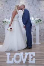 Photographers of Las Vegas - Wedding Photography - Love letter props in front of wedding couple