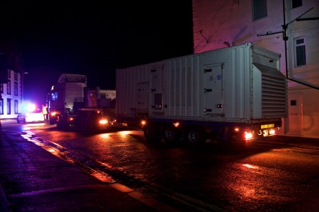 Bold Street, Morecambe, Lancashire, United Kingdom, 7th December 2015, A 110Kva Emergency Generator which has been brought from London, is reversed into position adjacent to the sub station in Bold Street Morecambe Electricity North West have deployed the Generators in an effort to restore power supplies to part of the Network which has been effected by the flooding from the River Lune which flooded the 33Kva Sub Station Supplying 55,000 homes in Lancaster, Morecambe and the surrounding Areas.