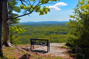 A bench sitting atop Mount Sabbatus offers a breathtaking view of western Maine near Lovell.