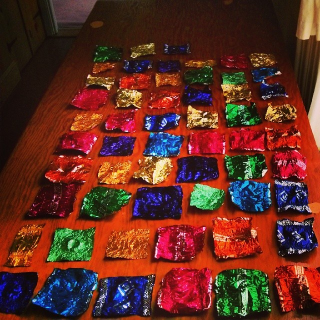 a photo of fifty-seven chocolate wrappers on a table