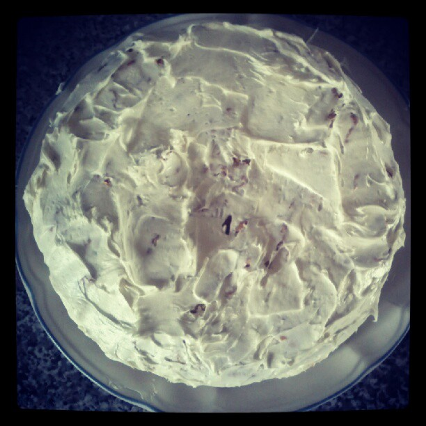 a photograph of a cake covered with white icing