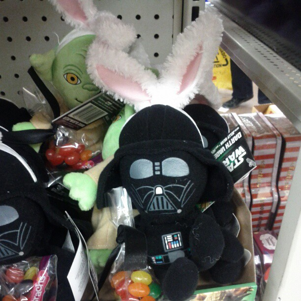 a photo of a darth vader doll wearing bunny ears