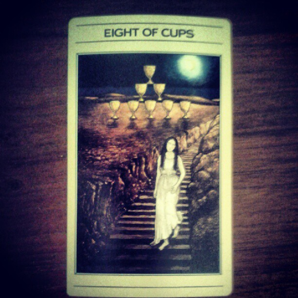 a photo of an eight of cups tarot card