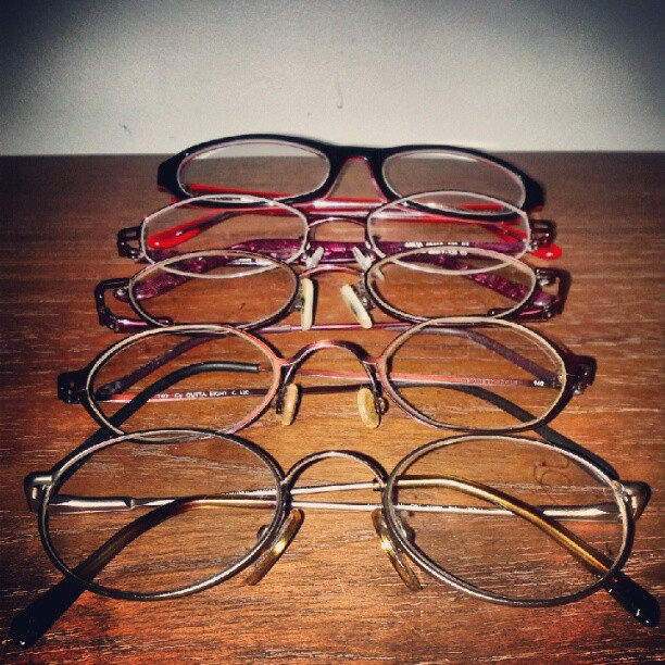 a photo five different pairs of glasses lined up from a different angle
