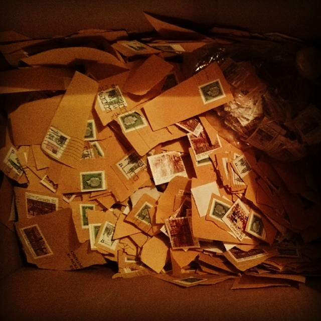 a photo of a box of used stamps