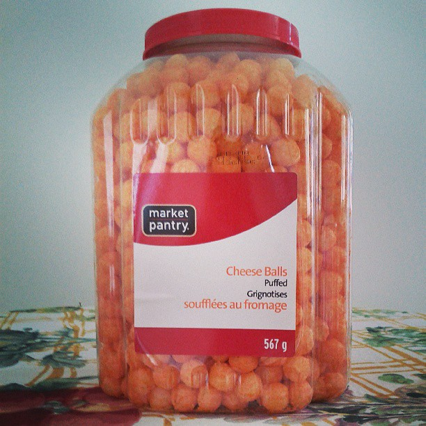 a photo of a giant container of market pantry puffed cheese balls
