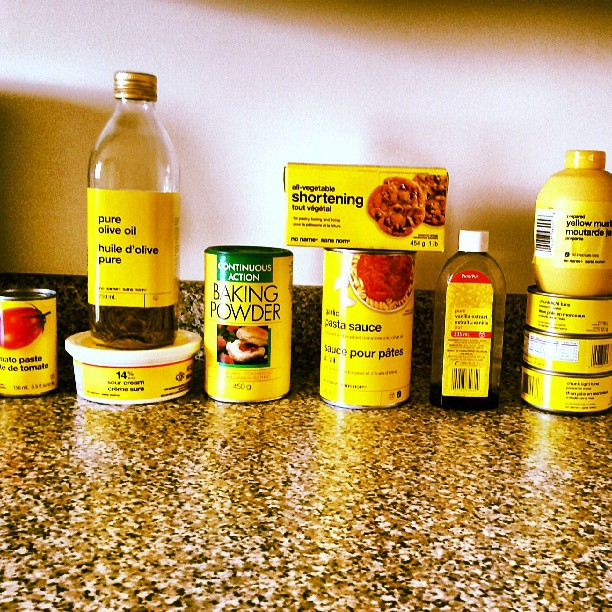 a photo of a bunch of yellow no name products sitting on a counter