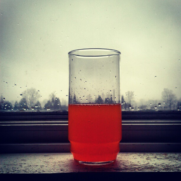 a photo of a glass of orange soda