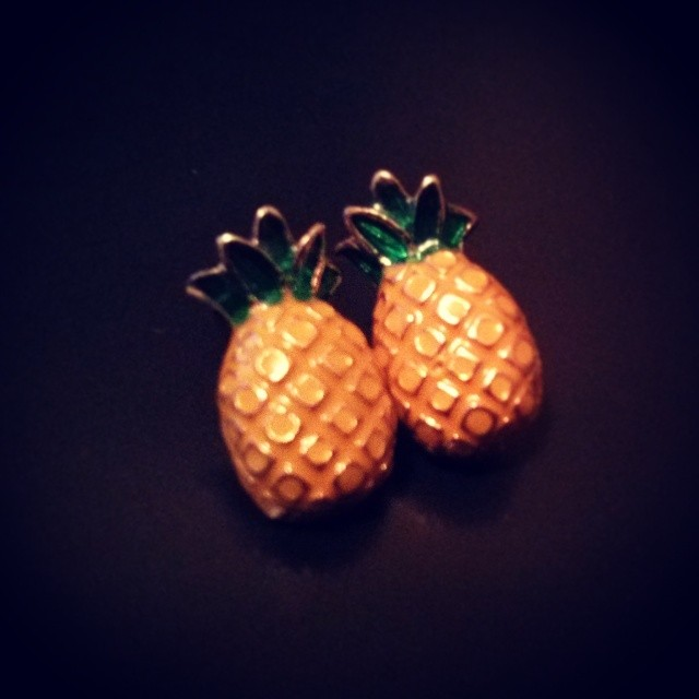 a photo of a pair of pineapple shaped earrings