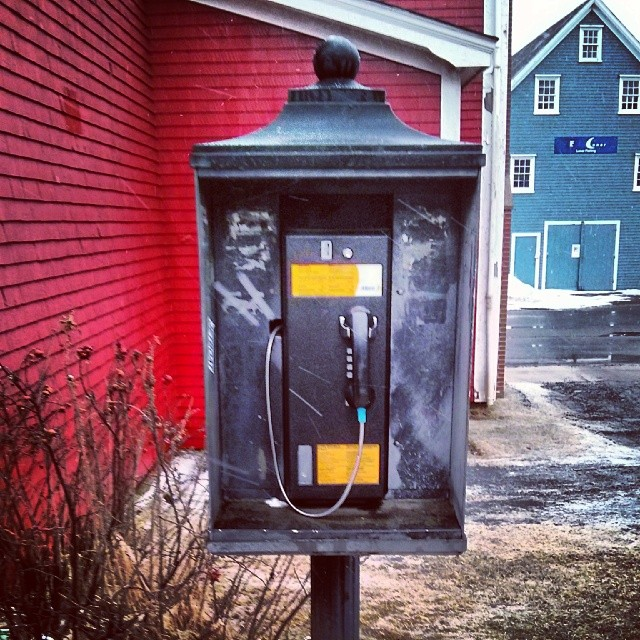 a photo of a public telephone outdoors
