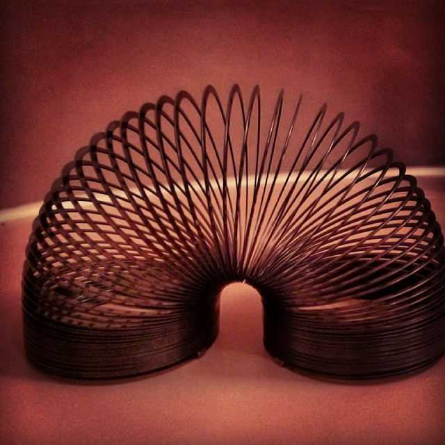 a photo of a slinky in an arch