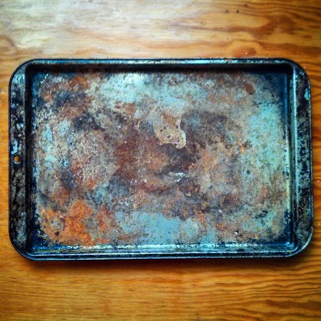 a photo of a very rusty old cookie pan