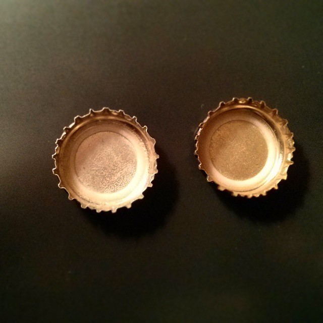 a photo of two upside down bottle caps