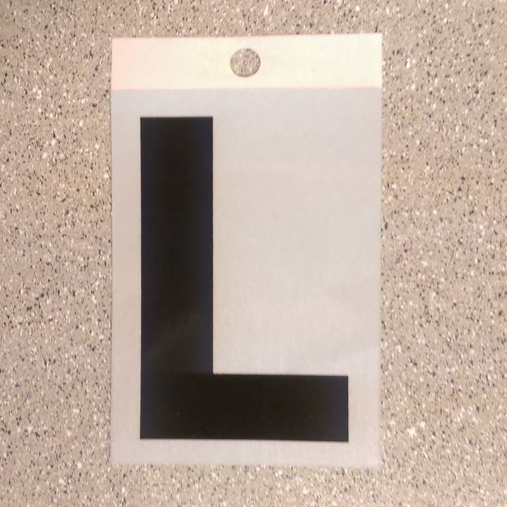 "a photo of a vinyl uppercase ""L"" sticker"