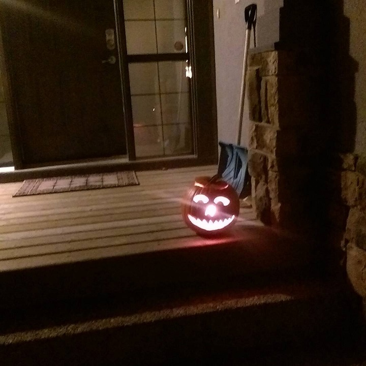 photo of a jack o' lantern on a porch