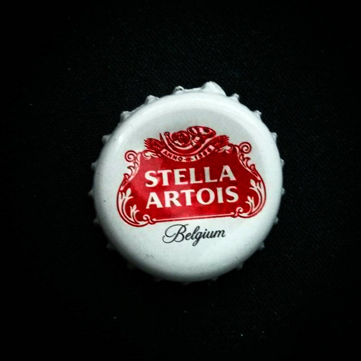 macro of a stella artois bottle cap