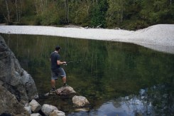 Image of a man fishing in a river