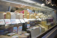 Various cheeses for sale at a delicatessen at Pike Place Market in Seattle