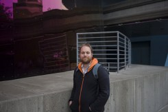 Man poses outside the EMP in Seattle