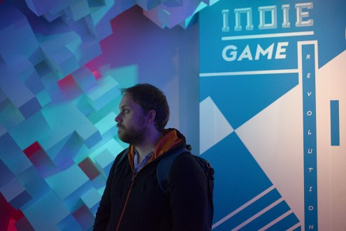 Man standing observing at Indie Game Revolution exhibit at EMP in Seattle