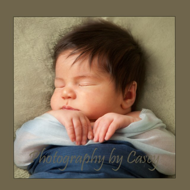 Photographer poses sleeping babies