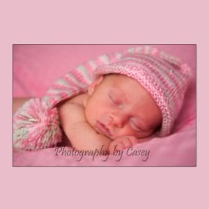 Photography of sleeping newborn in stockinghat