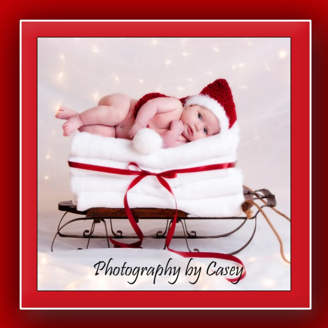 Photography of Sleigh with newborn baby