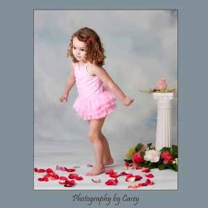 Photographer of girls playing wearing tutus